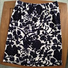 Knee length skirt This skirt has an interesting bleeding floral pattern... I'm not sure how to describe it so please look at last pic.  This is the style of the pattern, it's not a laundry accident. :-) It's a pull-on style with elastic waist band; very comfy and slinky. LOFT Skirts