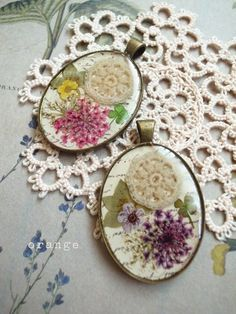 Resin. Could use my tiny doily and pieces of old embridery