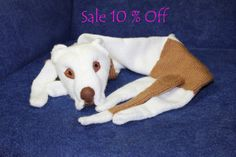 10 % SALE - Was $89 now $79.9  If you want other the dog scarf, send me a photo of your dog.  This scarf made from man-made materials.  A fantastic way to keep warm with this lovely dog curled up around your neck. Hand knitted white and biege scarf with a wonderful had sewn face for its unique character. His head is filled with polyfil. This is a guilt-free, animal-friendly knitted dog stole. The dog is knitted with soft yarn ( 100% acrilic). The dog is made as a tube. The dog can be hand…