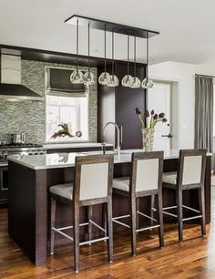 Modern kitchen with chocolate brown cabinets and pendant lights. Modern & Contemporary Kitchen Design Photo by Eric Roseff Designs Kitchen Designs Photos, Modern Kitchen Design, Eclectic Kitchen, Kitchen New York, Kitchen Paint Colors, Transitional Kitchen, Home Interior, Interior Design, Coastal Interior