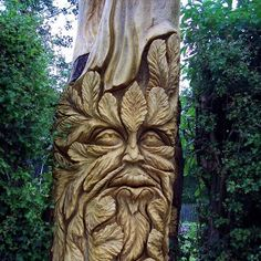 Greenman carved at the bottom of the faeries