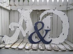 crackle finish and contrast between ampersand and letters