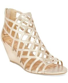 Material Girl Henie Caged Demi Wedge Sandals, Only at Macy's $49.99 Material Girl brings daring allure to your stylish look in these Henie sandals featuring striking, caged details and a demi wedge heel.