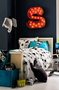 This kids' room from H&M is a case for going a little (or a lot) out of the ordinary. Skulls, a neon letter 'S', and stuffed animal taxidermy elephant. Kids Room Bed, Boy Room, Kids Bedroom, Kids Rooms, Bedroom Ideas, Bed Ideas, Home Wall Painting, Ideas Dormitorios, Teen Wall Art