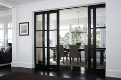 """Trend: Flexible doors for wide openings. With open floor plans and wider openings between spaces becoming more popular, interior bi-fold, double pocket and barn doors offer the ability to divide the space when needed or keep it open. """"We're finding that interior doors these days need to provide flexibility in space defining,"""" says senior associate Kyle Sheffield of LDa."""