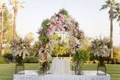Beautiful floral arch for an outdoor wedding altar