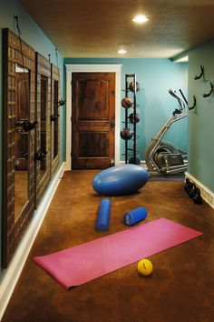 This narrow space functions well as a home work out space when mats and equipment are placed on an angle.