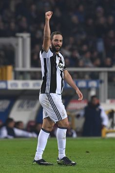 Gonzalo Higuain of Juventus FC celebrates his second goal during the Serie A match between FC Torino and Juventus FC at Stadio Olimpico di Torino on December 11, 2016 in Turin, Italy.