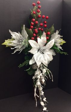 Christmas Memorial Grapevine Cross: red berries, silver poinsettias and frozen Pinecone cascading branch. Original design and arrangement by http://nfmdesign.synthasite.com/