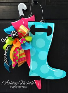 What a cute rain boot with umbrella door hanger that will go great anywhere. Can be personalized with an initial. Painted black on the back for a polished look. All of our door decorations are proudly hand painted in the USA! Wooden Door Signs, Wood Doors, Wood Signs, Wooden Door Paint, Wooden Letters, Candy Corn, Burlap Door Hangers, Wooden Hangers, Classic Doors
