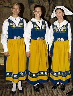 Queen Silvia, Princess Viktoria and Princess Madelen  wearing the Swedish national costume