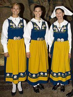 Queen Silvia, Princess Viktoria and Princess Madelen  wearing the Swedish national costume