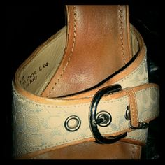Coach 3' inch sandals Worn quite a bit.  Size 9 medium. Nothing wrong with item except you can tell where the feet have been placed. Thats easy to polish off with leather cleaner. Authentic coach sandals. Canvas has no stains or tears Coach Shoes Sandals