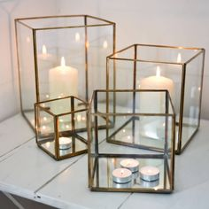 These stylish glass lanterns are beautiful in their simplicity.Small 11 x 11 x 11cm Medium 16 x 16 x 16cm Large 21 x 18.5 x 18.5cm Extra Large 27 x 21 x 21cmEach glass lantern has a mirrored base which reflects the candle light beautifully. These stylish glass lanterns are simple and sleek with glass sides and finished with a brass edging. The lantern looks great whether it has a tealight in it or a large pillar candle. Four sizes available All Nkuku products are Ethically produced and Fair…