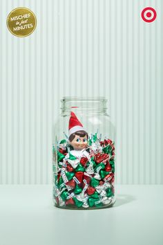 Sweet Mischief: Looks like our Elf On The Shelf is getting into the holiday spirit by getting into the holiday candy. One big jar, a big bunch of Hershey's Kisses and voila, suddenly someone's surrounded by holiday sweetness.