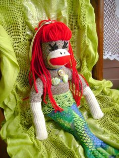 Coral the Mermaid Sock Monkey by DeedleDeeCreations on Etsy Use coupon code OCTOBER for $5 off of any item over $40.00.