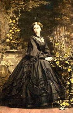 This victorian mourning dress has an elaborate trim. This style of dress has inspired fashion in the romantic goth culture