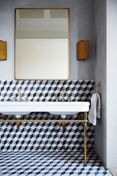 the most stunning graphic tiling balanced by elegant brass hardware