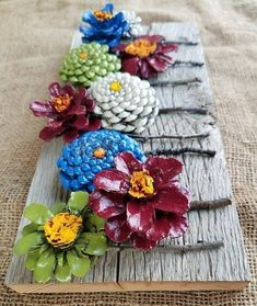 DIY Kissing Ball with Pine Cones - Crafts Unleashed@ handmade and painted pincone flowers on reused barn wood! These pi… - wood DIY ideasBeautiful handmade and painted pincone flowers on reused barn wood! Nature Crafts, Fall Crafts, Crafts To Make, Christmas Crafts, Arts And Crafts, Diy Crafts, Pine Cone Art, Pine Cone Crafts, Pine Cones