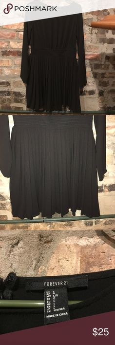 """Forever 21 Black Pleated Dress   NEVER WORN   L One of those Forever 21 finds that made me go, """"NO way anyone will think this is from Forever!!""""  Really gorgeous detailed stitching on the belt and pleats that hang fantastically!   Hits right above the knee. Pair it with some winter booties and a statement jacket!!  No tags but MINT condition - never worn!  Size L - parting with it because I have a long torso and the waist was a little high for my taste. ¯\_(ツ)_/¯ Forever 21 Dresses Mini"""