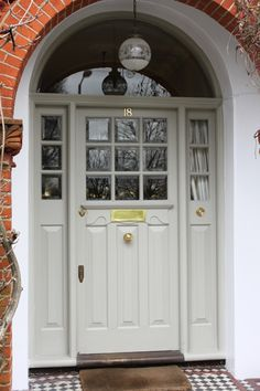 Single Entry Doors Late Front Door South London How To Choose Suitable Home Theater Arched Front Door, Victorian Front Doors, Front Door Porch, Grey Front Doors, Front Door Entrance, House Front Door, Front Door Colors, House Doors, House With Porch