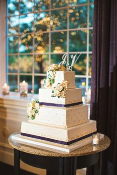 Four tiered white wedding cake with crystal embellishments and white sugar flowers | Aevum Photography