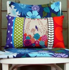 Google Image Result for http://www.cosyhomeblog.com/wp-content/uploads/2011/06/multi-coloured-fabric-bird-cushion-296x300.jpg