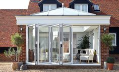 Beautiful white bi fold doors on this orangery extension make this an amazing modern addition to an already stunning home. Bungalow Extensions, Garden Room Extensions, Orangery Extension, Patio Enclosures, Outdoor Doors, Folding Doors, Home Reno, Conservatory, Modern Classic