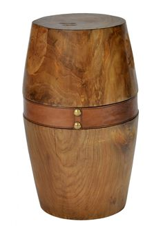 The smooth, clean re-invention of a primitive stool makes the Woody a great little addition to a contemporary organic decor. Rich teak grain is detailed with a luxe leather strap and brass studs.