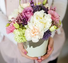 centerpiece... flowers in a galvanized pail that has been dipped in your color of paint for a little something extra :)