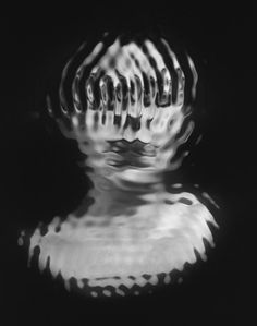 "French photographer Laurence Demaison sometimes combines black and white photos with her own drawing, generating a ghostly finished product. ""Tak..."