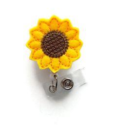 Sunflower  - Retractable ID Felt Badge Holder - Name Badge Holder - Cute Badge Reel - Nursing Badge - Felt Badge Reel by BadgeShack on Etsy https://www.etsy.com/listing/163248075/sunflower-retractable-id-felt-badge