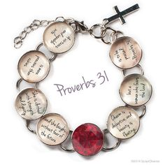 """Proverbs 31 Woman - Glass Charm Bible Verse Bracelet by ScriptCharms. More precious than rubies. You'll cherish this beautiful silver plated metal and glass bracelet with verses from Proverbs 31 and a gorgeous red rhinestone:  """"A virtuous and capable wife is more precious than rubies. She is clothed with strength and dignity, and she laughs without fear of the future. Charm is deceptive, and beauty is fleeting; but a woman who fears the Lord is to be praised."""""""