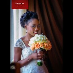 """Nigerian bride in white wedding dress for church wedding with white and light orange roses bouquet. From Instagram @atunbi's photo: """"#Tele and #theatunbiexperience .#Photo by #atunbi."""