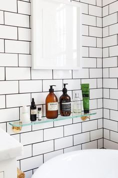 Love the black grouting on the white subway bathroom tiles