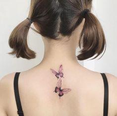 Pink butterflies by Tattooist Flower
