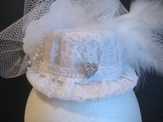 Veiled Mini Top Hat with Rhinestone Heart Pin and pearl accents. DetailsandFairyTales.com