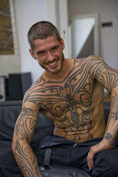 Men with tats jerk each other off