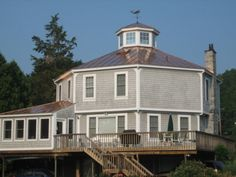 New copper standing seam roof on octagon house overlooking the Hudson ... Love the light gray & white with the copper.  Gorgeous!