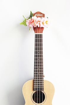This is ribbon lei for ukulele. This is the head accessories of ukulele.It is made with ribbon. the fiower name is pink plumeria.  Size is free. (This