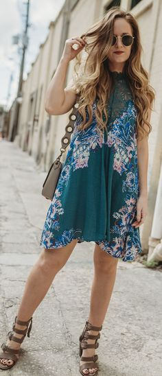 Boho spring outfit styled with floral Free People swing dress, block heel buckle sandals, and ring bag #springstyle #springoutfit #freepeople
