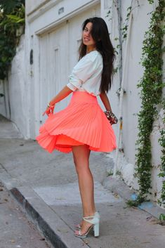 Rock this coral accordion skirt all summer long.