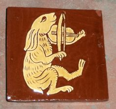 Bunny violinist (from Recueil de Romans de la Table Ronde - Lancelot du Lac). Sgraffito, Valentine terracotta, white e/w, honey glaze (CTM G4, 5% Bath Potters natural red iron oxide) 1145 bisque, 1080 glost (Tanglebank Tiles)