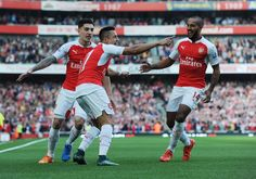 Alexis Sanchez celebrates scoring the 1st Arsenal goal with Hector Bellerin and Theo Walcott, against Manchester United at home, 2015. This would be a fun image for a caption contest. So many great things could be said.