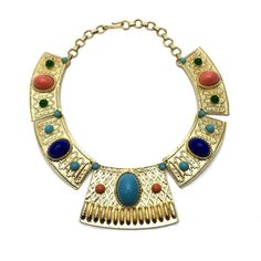 """Juliana Egyptian Revival Necklace, Vintage, 1930s to 1980s   An outstanding example of the best vintage costume jewelry, this stunning statement necklace is featured on the cover of the book """"Juliana Jewelry of D&E, The Last Generation"""", by Paula Knutson & Karla Wacker. Made in the 60s to the 70s, styled as a collar worthy of an Egyptian monarch. Bright, thick gold plating is contrasted by large and small oval Lucite cabochons imitating Turquoise, Coral, Green Onyx and Lapis Lazuli. The…"""