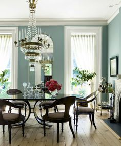 Blue dining room walls, thick white molding, light wood floors
