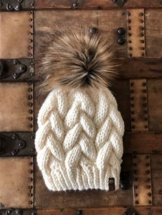 Hand knit fitted braided cable beanie with a faux fur pom. Made with bulky yarn so it's thick and super squishy!The faux fur pom is attached with a snap so that it can be easily removed if you need to wash the hat. Thick Yarn, Fur Pom Pom, Crochet Yarn, Hand Knitting, Knitted Hats, Faux Fur, Cable, Winter Hats, Braids