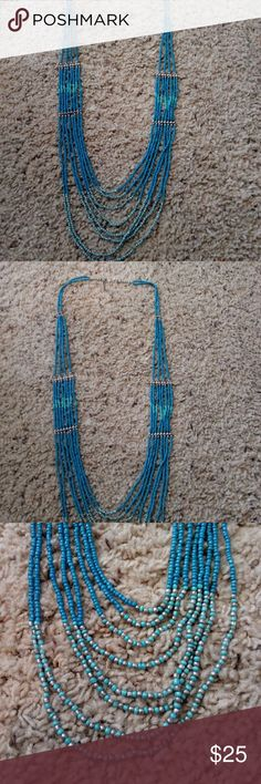 """TURQOISE COLOR NECKLACE LONG 44"""" TURQUOISE COLOR BEADED NECKLACE!! See pic as part of description..  Multiple layers!!  Has silver color spacer bars.. Lays very nice on neck. Stunning with a white T shirt and jeans for that SW appeal!! Also looks great with a little black dress!! Dress it up or dress it down!! Versatile piece!! unbranded Jewelry Necklaces"""