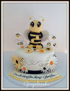 Honeybee - This sweet little bee is for a retiring teacher who called her students, her honeybees. I made the large bee with aluminum foil covered with fondant to reduce the weight on the cake.  Hope you enjoy.
