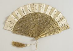 1870 Folding Fan  Culture: French  Medium: Silk, gold, mother-of-pearl, brass